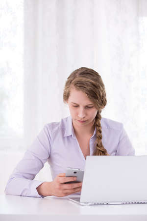 awful: Young woman is reading awful text message Stock Photo