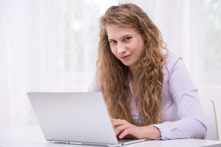 awful: Young woman is rude and awful on the internet Stock Photo