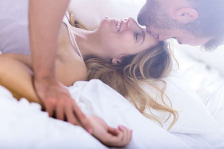 female sex: Young passionate married couple during morning sex Stock Photo