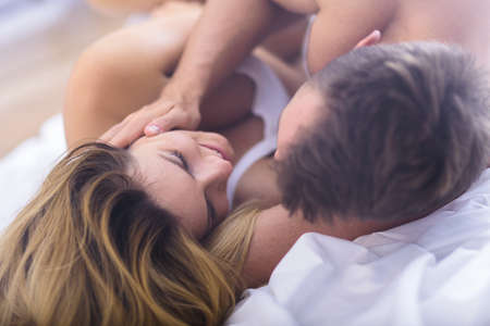 romance sex: Young lovers during foreplay before morning sex