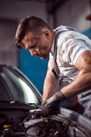 mechanist: Picture showing male mechanic working with wrench Stock Photo