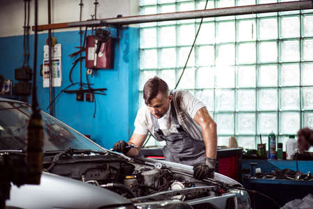 car service: Mechanic is checking if all car parts are working Stock Photo