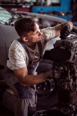mechanist: Mechanic is checking all components of car engine