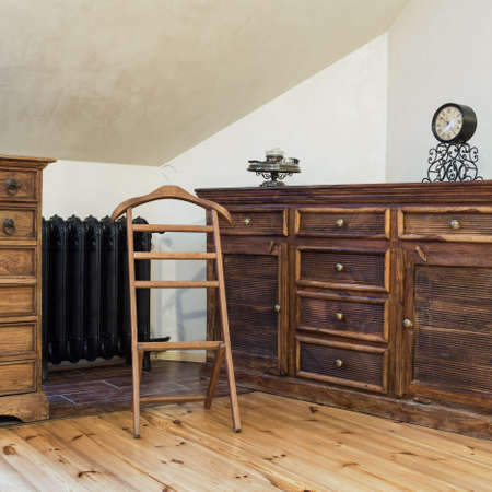 vintage furniture: Cloudy home - brown wooden old fashioned dresser Stock Photo