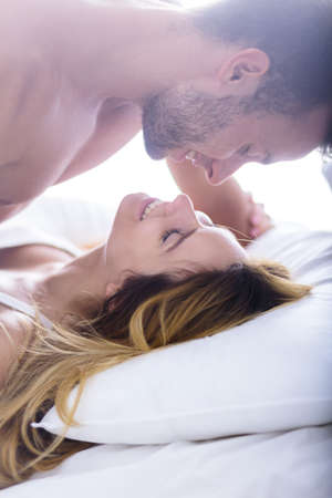 foreplay sex: Happy couple during foreplay in the bedroom