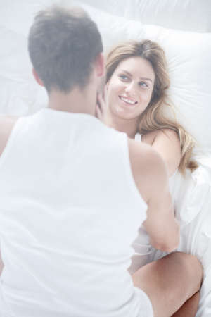 nude wife: Young couple during morning sex in the bedroom Stock Photo