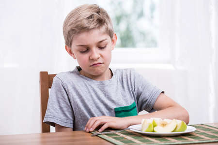 stubborn: Boy doesnt like fruit and refuses to eat them Stock Photo