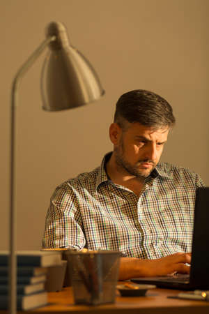 isolation: Image of handsome working man sitting at computer