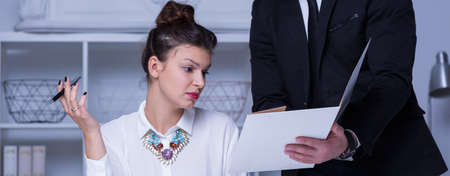 inferior: Working with severe businesswoman is very stressful