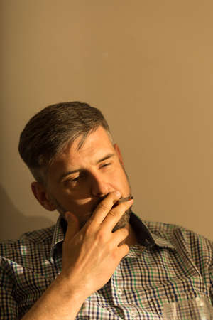 brunets: Picture of male brunet puffing on a cigarette Stock Photo