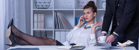 earnest: Young female boss is very severe and hard Stock Photo