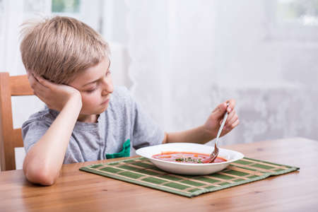 no food: Kid with no appetite playing with food Stock Photo