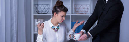 Personal assistant is preached by his boss Stock Photo