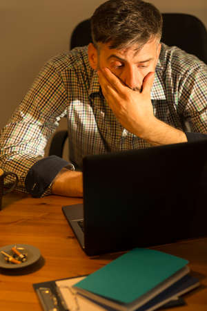 isolation: Image of tired busy male working on computer
