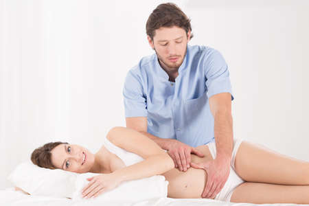 Physiotherapist doing abdominal massage in the pregnancy