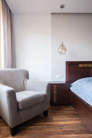 roomy: Comfortable armchair and bed in the bedroom