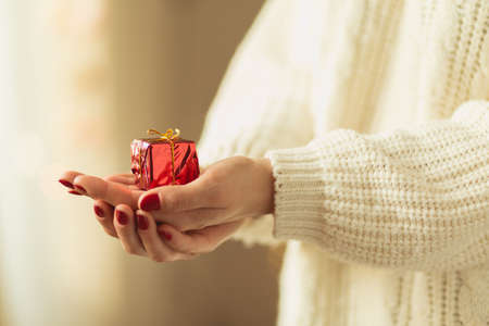 hold hands: Close-up of small gift on the hand