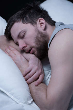 tiresome: Close-up of young man in deep sleep