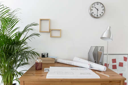working desk: Creative space with house plans on the desk Stock Photo