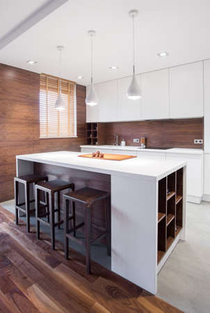 White and modern kitchen island in the house Stock Photo