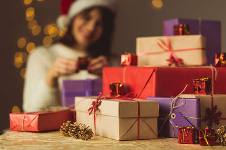 Image of smiling girl opening Christmas presents