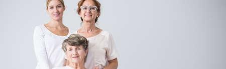 grandma: Happy beautiful family girls holding together