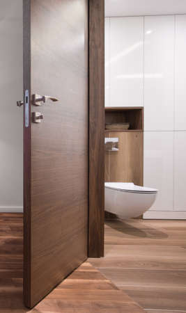 roomy: Open door to the white and modern bathroom