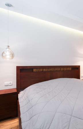 stark: White linen bed in the stark bedroom