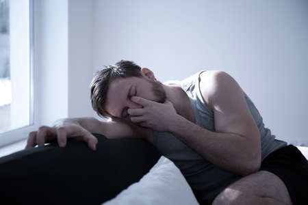 sleepless: Man tired after sleepless night, horizontal photo Stock Photo