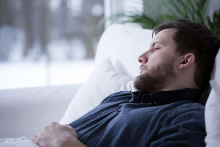 tiresome: Man having a nap during day, horizontal