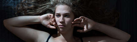 sleeplessness: Young woman has sleeplessness night because of man