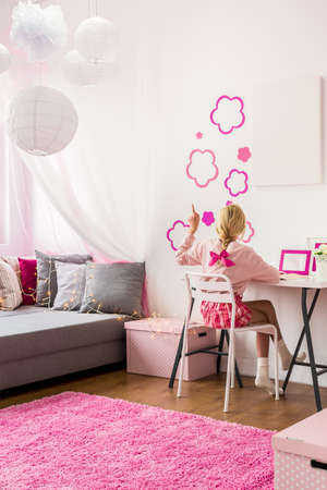 bedroom wall: Image of girly bedroom with pink wall decoration