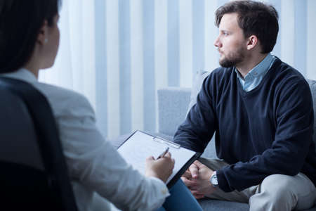 Image of young man during psychological therapy Stock Photo
