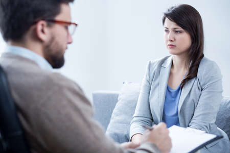 psychologists: Young woman during therapy at psychologists office
