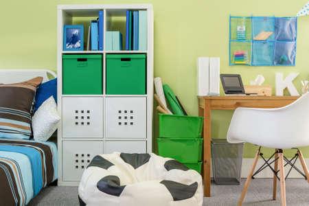 bean bag: Green boys room with bean bag chair Stock Photo