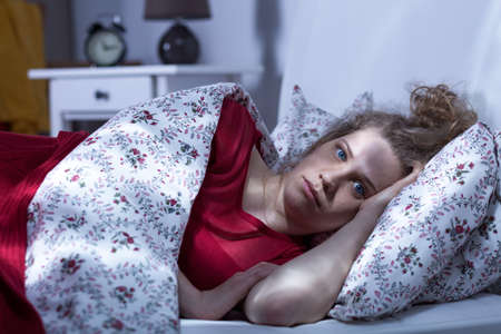 Young depressed woman cant sleep at night