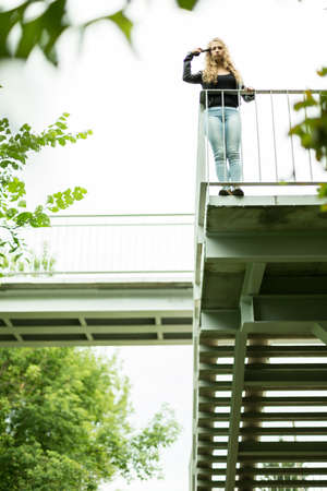 suicidal: Mad girl committing suicide on the viaduct