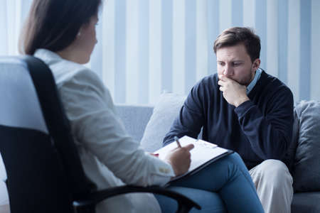 couching: Female psychiatrist or psychotherapist talking with patient