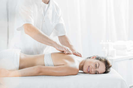 happy client: Happy client during relaxing massage in spa