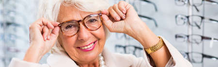 rimmed: Elegant grandmother in fashionable red rimmed glasses Stock Photo