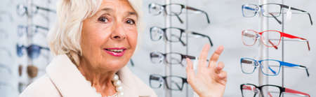 difficult: Optician patient and difficult choice of glasses Stock Photo