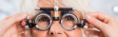 shortsighted: Senior woman with trial frame for lens determination