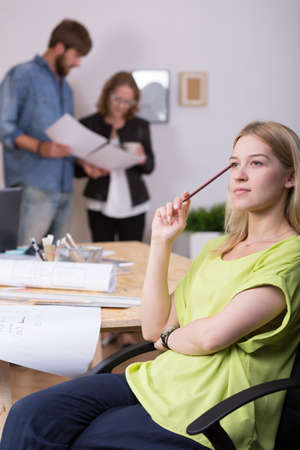 inventive: Picture of young female inventive graphic designer during work Stock Photo