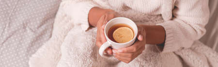 blanket: Cup of tea with lemon to warm up Stock Photo