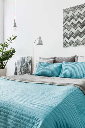 Photo of turquoise decorative bedding in new bedroom Stok Fotoğraf - 48079252
