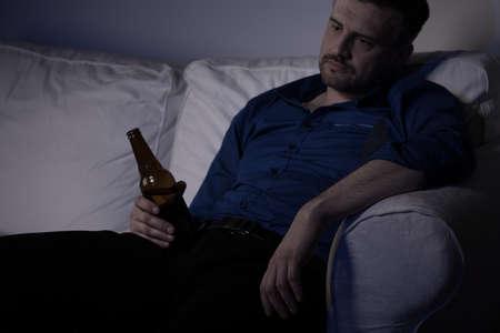 miserable: Heartbroken man feeling miserable and drinking alone