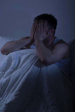 insomniac: Tired desperate frustrated man with sleep problems Stock Photo