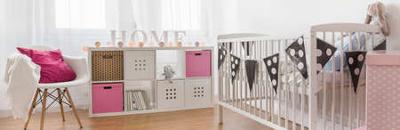 bassinet: Baby girl nursery ideas with cute decorations Stock Photo