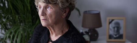 widow: Panorama of elderly widow afraid of being alone