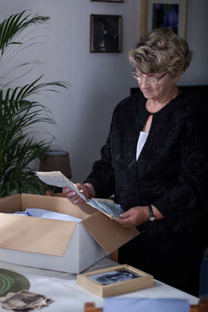 old letters: Widow reading old letters from dead husband Stock Photo